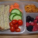 Spinach Artichoke Hummus Sandwich cut in triangles, Assorted Veggies, Pretzel Chips, Mixed Berries