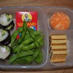 Leftover Homemade Sushi, Edamame, Yogurt Raisins, Fig Newtons, and Clementine