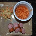 Baked Beans, Broccoli Slaw in a mustard vinaigrette, Kielbasa.