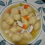 Matzoh Ball Soup with carrots, celery and chicken.
