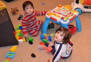 Playing together and making a mess in the basement.