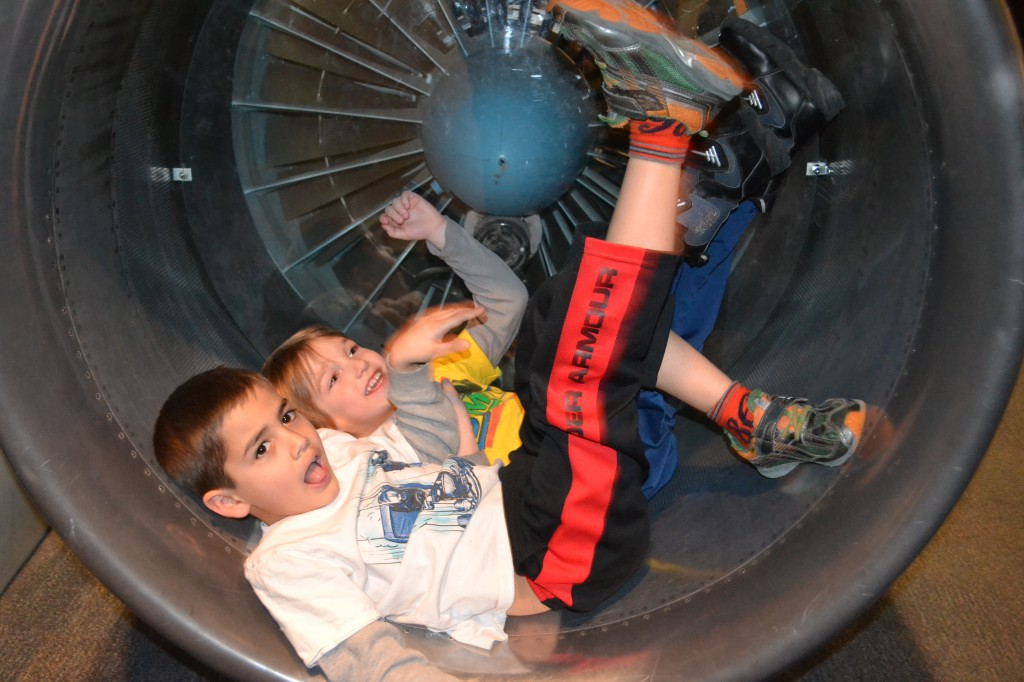Jack and Luke in an airplane engine.