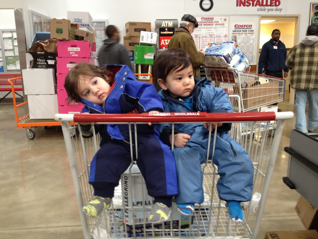 Growing up - they can sit up and fit into the Costco cart now.