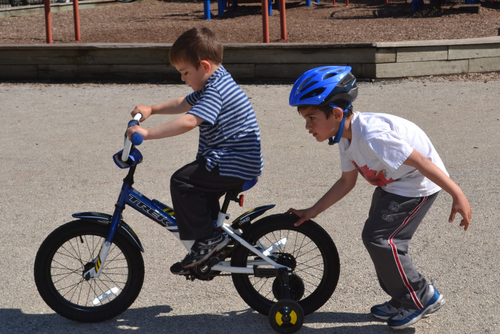 Jack teaching Ben to Ride a Bike.