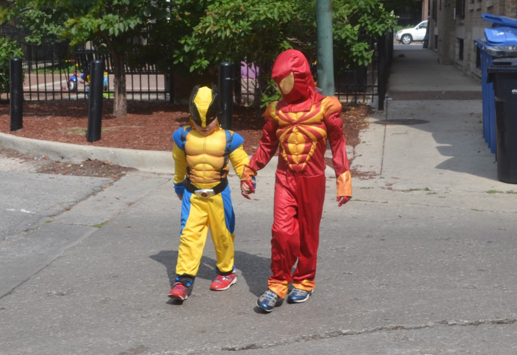 Superheros know you must hold hands to cross the street.