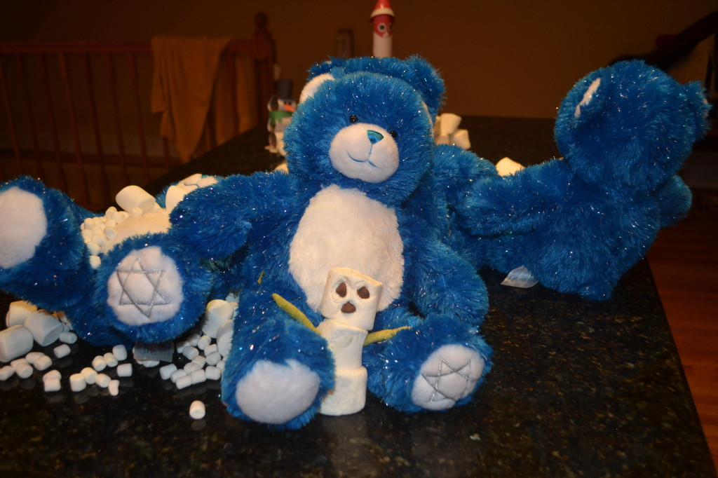 This bear in the back preferred to built a marshmallow man, not sure what the one next to him is doing. Laying in marshmallow?