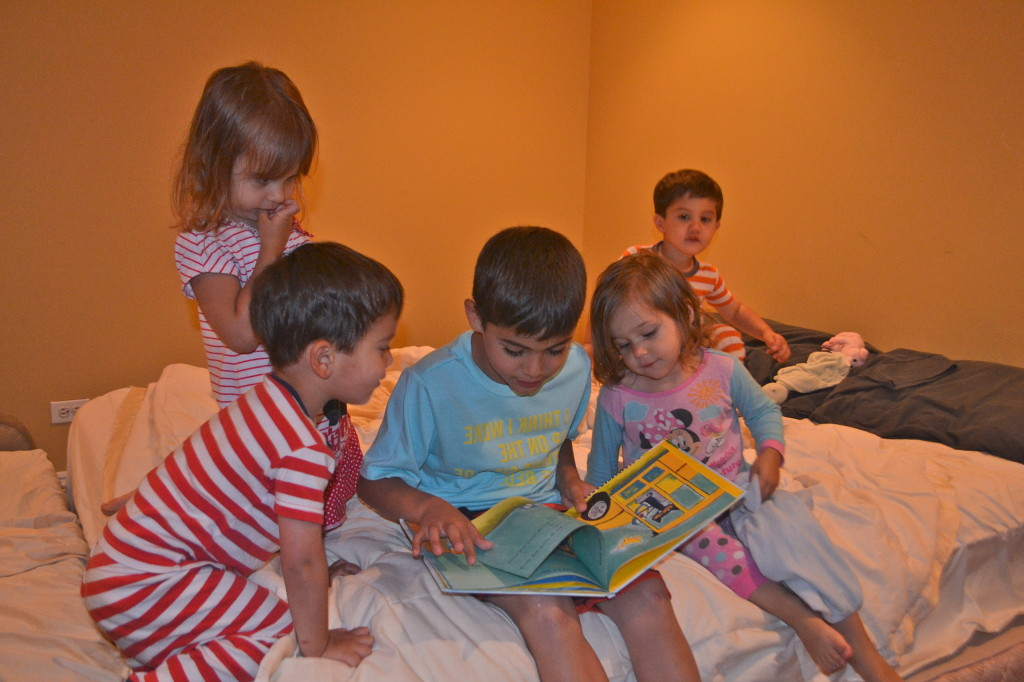 Jack reading 'Pete the Cat' to the littles.