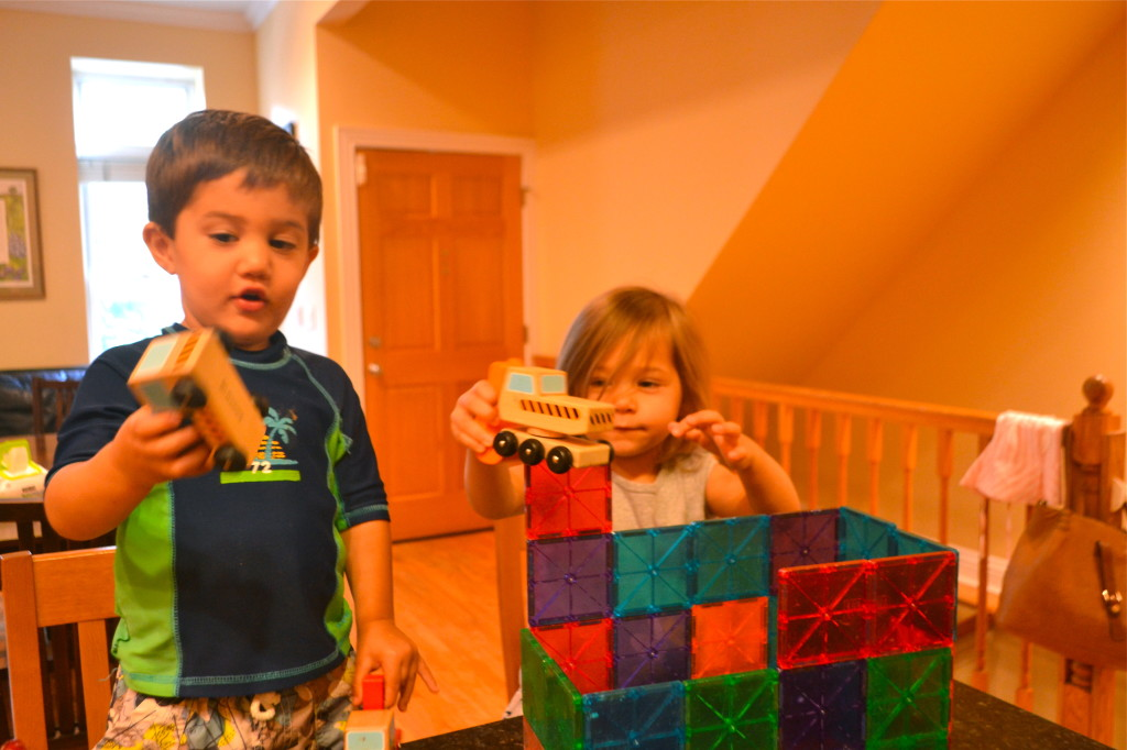 Sam and Indigo built a castle for her, then put construction vehicles in it for him.