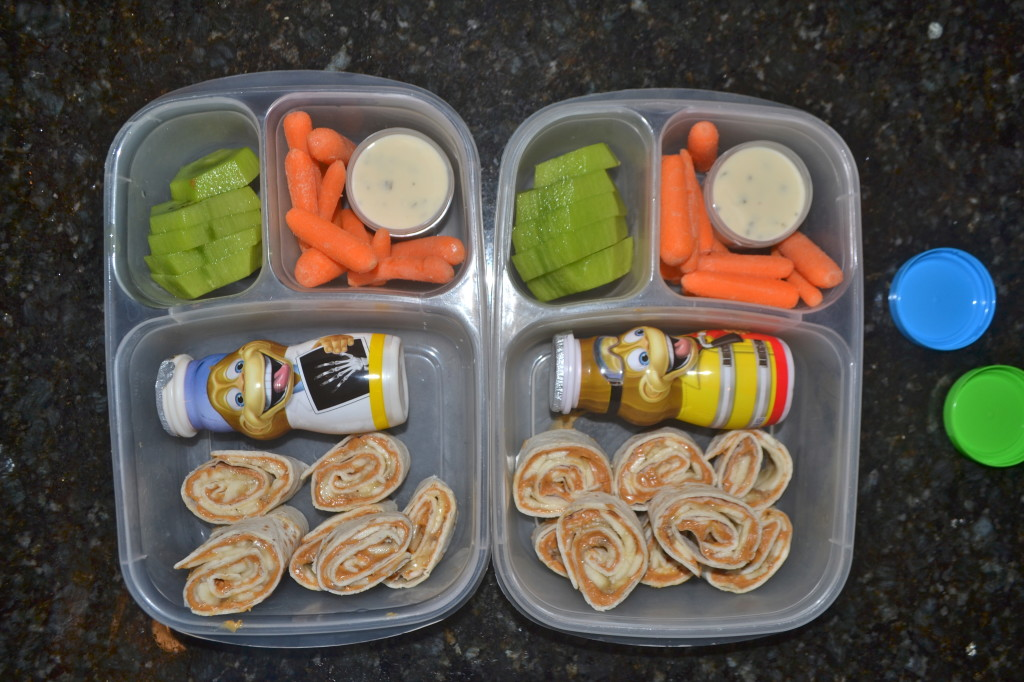 Peanut Butter and Banana roll ups, yogurt drink, carrots and ranch dip, kiwi.
