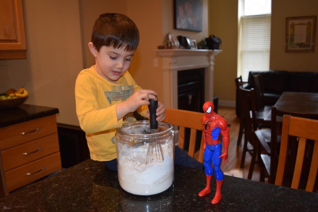 Sam helps mix the America's Test Kitchen Gluten Free All Purpose Flour