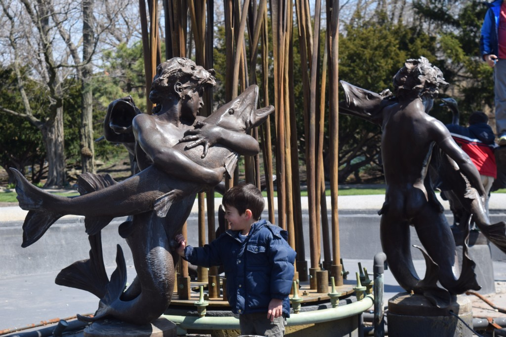 Aaron inappropriately touching the statues and laughing hysterically.