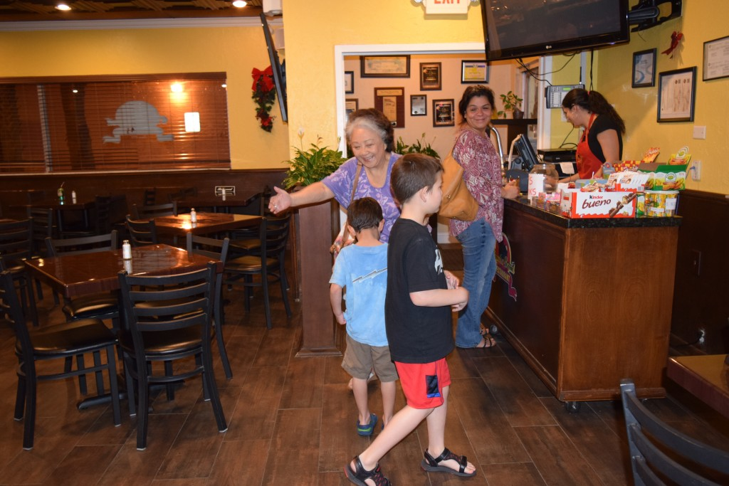 Mom see the kids for the first time at the Brazilian Buffet.