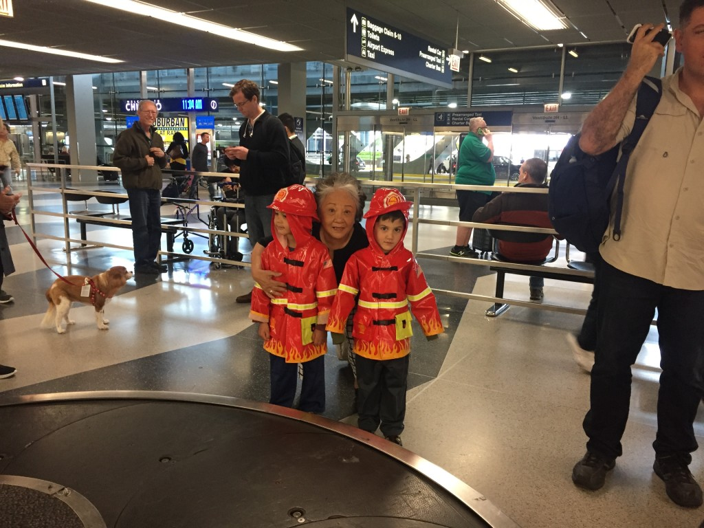 I picked Mom up at the airport with my two firemen escorts.