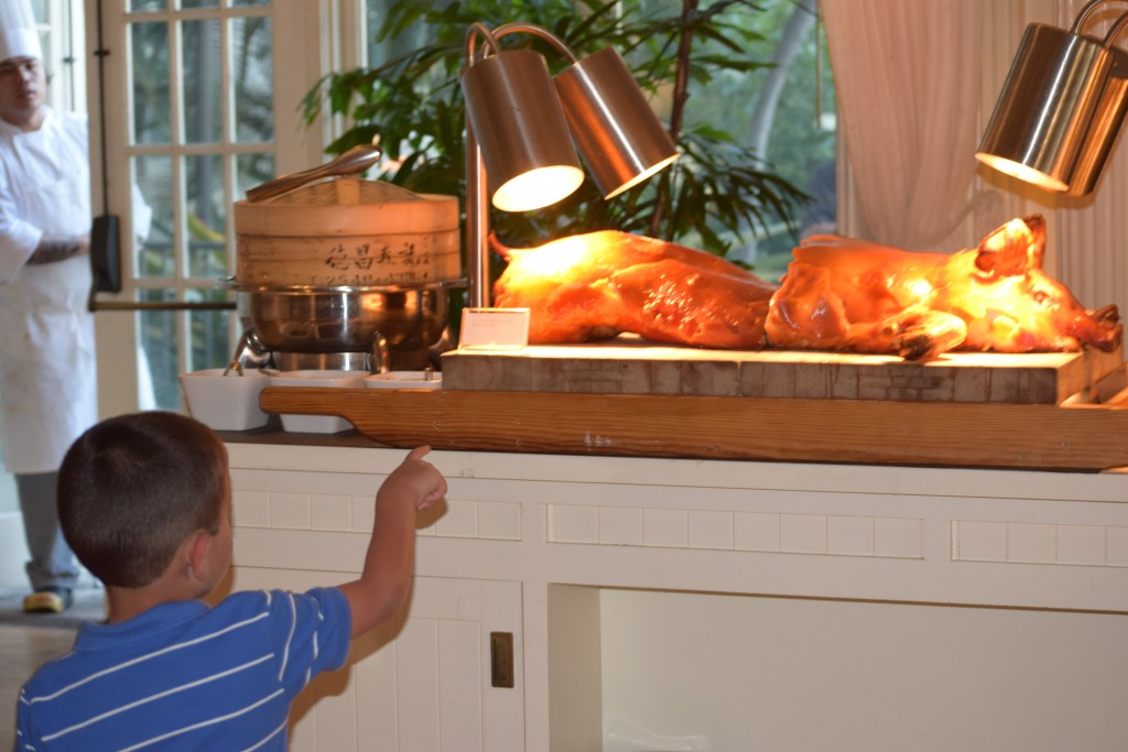 Aaron was fascinated by the full pig.