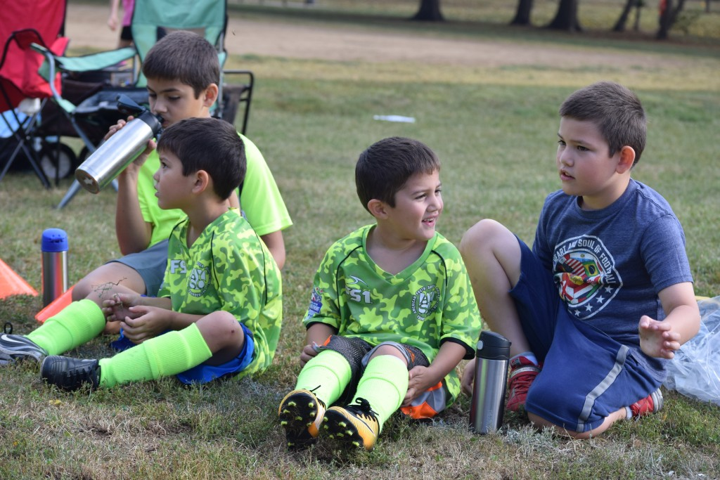 On the sidelines with their older brothers.