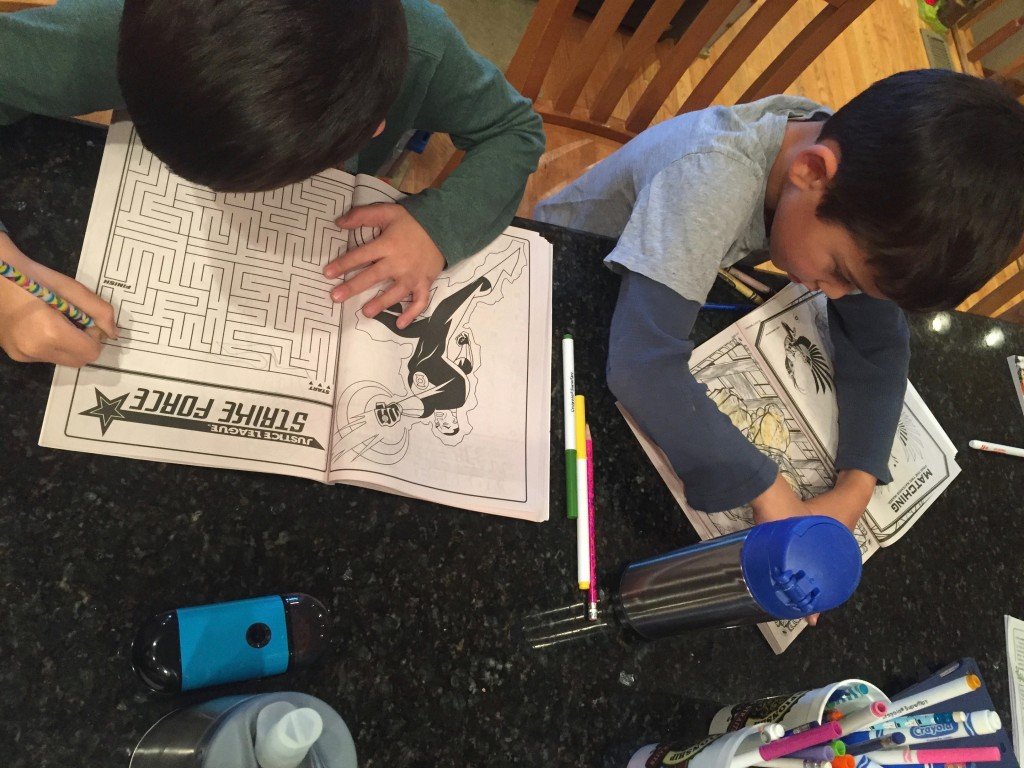 Aaron loves to color, Sam prefers the puzzles.