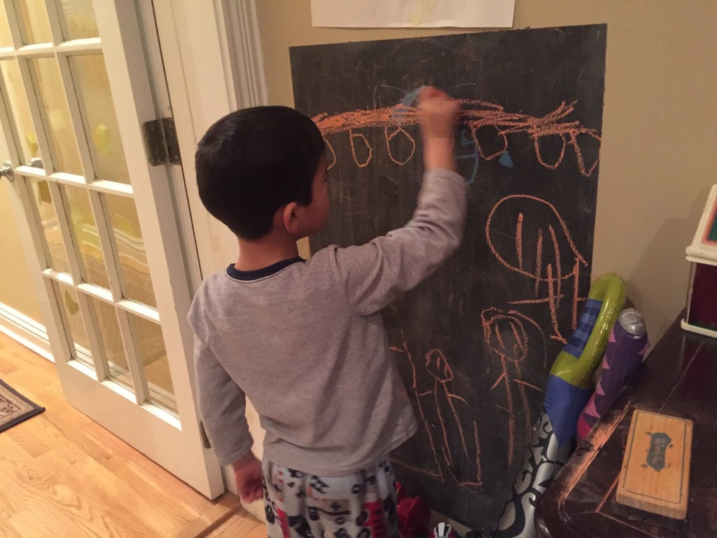 The twins rediscovered the chalk board in their room.